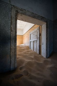 Ghost town engulfed by mounds of sand photographed by Romain Veillon