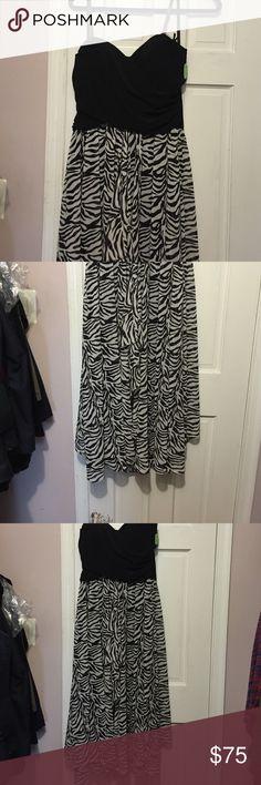 Strapless dress Strapless dress, black on top, black & white on bottom. Brand new with tags Joseph Ribhoff Dresses Strapless