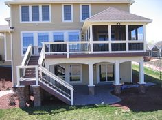 Love the enclosed porch, decking, and stairs to the lower level.