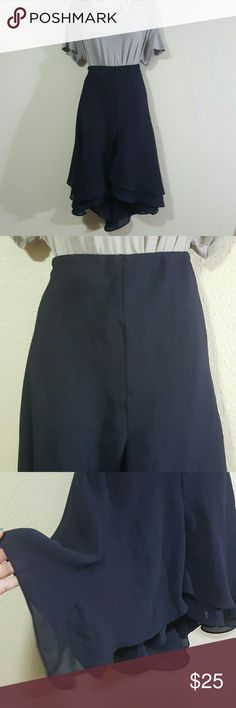 Cato navy blue ruffle skirt Never worn.  Beautiful 2 layers skirt. Outer layer is sheer. Elastic waistband on back half. Waist 15 inches. Waist 20 inches stretched. Length 23 inches  in front Length 28 inches in back. Cato Skirts Midi