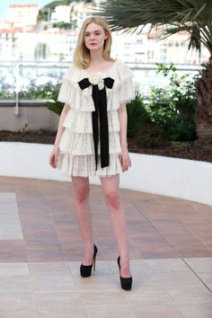 <p>Elle Fanning looked positively angelic doing press for <i>The Neon Demon </i>in a ruffled Chanel minidress. <i>(Photo: Getty Images)</i></p>