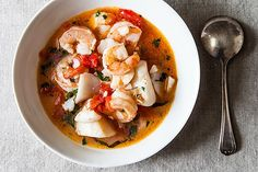 Dads Favorite Seafood Stew: shrimp, sea scallops, tomatoes, basil, and white wine. A fast 20 minute meal! #Recipe