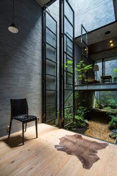 Dark Grey Industrial Interior Design in Nara House by Fuji Architects