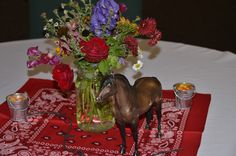 Fresh garden flowers in mason jars, Breyer horses, tiny galvanized buckets and red bandanas. Western BBQ theme dinner.