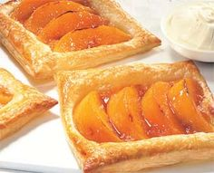 Easy peach puff pastry recipe - tried this today, was great. But instead of cutting each sheet into four, I cut it into 12 - 4 across, 3 down. One slice of peach on each, absolutely perfect.