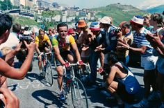 21 Jul 1986, Alpe-d'Huez, France Bernard Hinault right, and Greg Lemond, wearing the leader's yellow jersey, climb the Alpe d'Huez mountain pass during stage 18 of the 1986 Tour de France