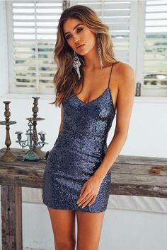 You'll always be the center of attention when you're wearing our sparkly Fashion Capital Dress! This style has a V neckline, padding on the bust and it has stretchy crossover shoulder straps. It also has an invisible side zip and looks SO stunning when pa Elegant Dresses, Pretty Dresses, Sexy Dresses, Casual Dresses, Dresses For Work, Summer Dresses, Awesome Dresses, Short Tight Dresses, Mini Dresses
