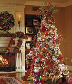 Great Example of a designer tree!  Notice the use of the ribbon, spiral sticks, and ornaments!!!