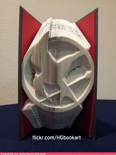 """A fan has turned the first book of the """"Hunger Games"""" into the mockingjay logo from the series. It was created by folding each page inside to form the full design."""