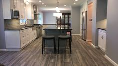 What an incredible #Remodel project we just finished in Olney, MD. We knocked down some walls to give this space an open concept and what a difference it made!! Brand new flooring, cabinets, countertops, lighting and fixtures makes this design one of our favorites!! Such a gorgeous #KitchenRemodel done by our #MSCteam #ModernStyleConstruction #MSCwork #RemodelingDC  #HomeRemodel #InteriorDesign