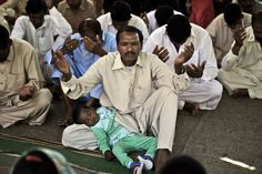 Easter 2013 Around The World  A Pakistani Christian child sleeps on her father's lap while he and others pray during an Easter Mass in Islamabad, Pakistan, Sunday, March 31, 2013. Pakistan's Christians, are celebrating Easter Sunday along with many other Christians around he world. (AP Photo/Muhammed Muheisen)