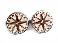 """Handmade sterling silver cufflinks by Jenkins with scrimshaw by Scott Judge on ancient mammoth ivory. We do not get many of these compass rose Judge cufflinks anymore, but whenever we do they are always first rate. Great work, as usual. Size: 3/4"""" Diameter  Price: $275.00 -- on ScrimshawGallery.com #cufflinks #jewelry #scrimshaw"""