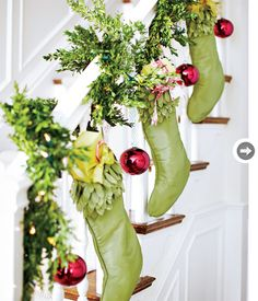 No fireplace mantel?  Here's a perfect solution -- embellish your stairway with garland, stockings and a few bright ornaments - spectacular!