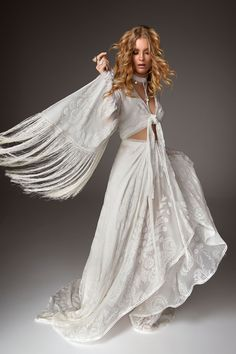 Rue De Seine Love Spell Collection // Super rock 'n' roll, with gypsy vibes... This boho fringe wedding dress has us swooning!