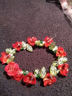 Check out this item in my Etsy shop https://www.etsy.com/listing/254086664/red-roses-and-leaves-bracelet. SOLD