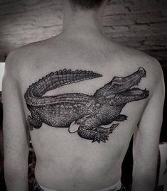 Crocodile tattoo on the upper back. Back Tattoos, Skull Tattoos, Tatoos, Krokodil Tattoo, Blackwork, Snake Tattoo, Tattoo Inspiration, Crocodile, Tatting