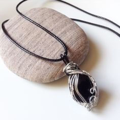 """Wire wrapped glass crystal bead ⭐️ The pendant is 40mm long and 20mm wide. ⭐️ You can choose a smooth leather cord necklace or a snake chain. ⭐️ Leather cord is 18"""" or 20"""" long. ⭐️ Silver plated snake chain which is 16"""" or 20"""" long. ⭐️ If you have any questions, just send me a message. ⭐️ This eye catching pendant can be a perfect gift, or as a little treat for yourself :) ⭐️ ⭐️ This will be supplied in a gift bag. Postage £1.00 You can also find me on Instagram @linniesjewels ⭐️ #pendant…"""