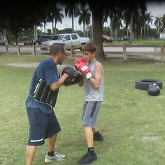 Helping out the youth boxing making sure they stay focus