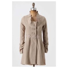 """Anthropologie Alice In Autumn Sweatercoat Stand out in whimsical boiled wool when you don this coat, whose ruffled collar and detailed waist are sure to dazzle. By Charlie & Robin. Button front  Wool  31""""L Anthropologie Sweaters Cardigans"""