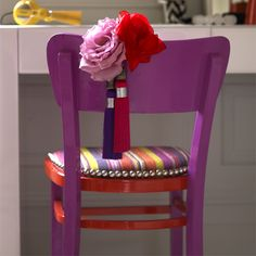Add 3D and exotic colour to old chairs. Paint the chair back and legs magenta, then highlight the seat edge and struts with a hot orange gloss. Choose a bright for the seat cover like the multi weave stripe fabric (£14 per metre at John Lewis) and tack with oversized upholstery studs. Finish by hanging a bright faux-flower and tassel corsage on the chair back.
