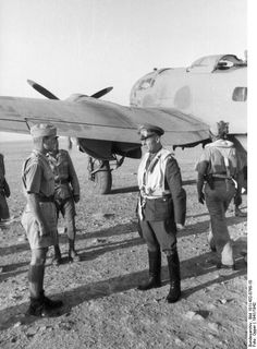 German fighter pilot Joachim Müncheberg and General Erwin Rommel in front of a He 111 aircraft, North Africa, 1941-1942