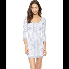 SALE Free People Printed Long Sleeve Bodycon Dress Fabric: Ribbed activewear jersey. 92% nylon 8% spandex. Size: M/L. Free People Dresses