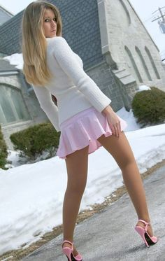 Short pink skirt with gorgeous suntan reinforced pantyhose legs and heels.. Want some???? Yes.....
