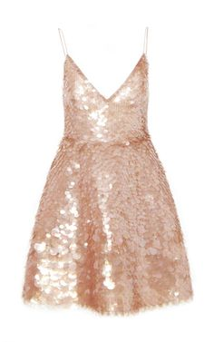 This **Monique Lhuillier** cocktail dress features a v-neckline, tank straps, a fitted bodice, and all over sequin embellishment.