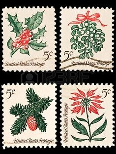 A variety of four Christmas postage stamps. Sprig of conifer,..