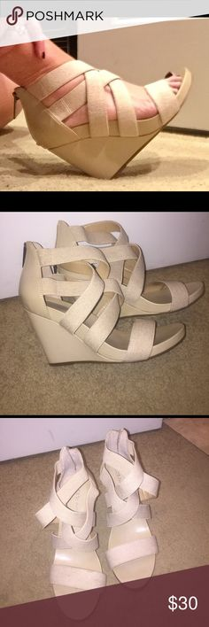 "BCBGeneration Strappy Wedge Sandals EUC BCBGeneration Strappy Wedge Sandals EUC. Beige, leather and wide elastic bands, zippers on back, 4"" wedge, nonslip bottoms.  There is a small speck of coffee on one strap. You have to look to see it. BCBGeneration Shoes Wedges"
