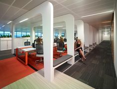 Activity based working - create spaces catered to specific work tasks and activities. Contemporary office designs, complete with unique individual work spaces, collaboration spaces and orange, beige, and grey floor designs. The diverse interiors create exciting work environments within corporate settings.