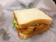 The Famous St. Paul Sandwich: It's an egg foo young patty, with lettuce, pickle and mayo, on white bread.