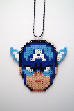 He encontrado este interesante anuncio de Etsy en https://www.etsy.com/es/listing/112606014/captain-america-necklace-marvel-comics
