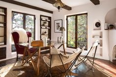 Stained glass windows & exposed beams give this LA home office tons of style and character.