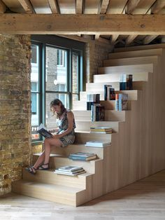Amin Taha Architects peels back layers of plasterboard to create open-plan offices.