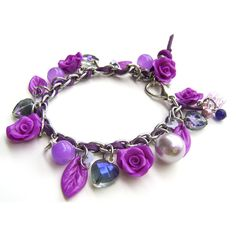 NEON - Purple Stainless Steel and Polymer Clay Charm Bracelet - With... ❤ liked on Polyvore