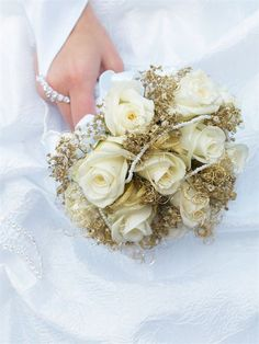 Complete with gold detailing; with less fresh flowers required this is a cost effective addition to your bouquet.