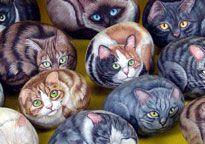 Chats peints sur des roches.
