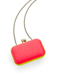 "$59.98 NEON CLUTCH - PINK/YELLOW: Be chic in the heat with this bright, neon clutch! 6"" x 4"" hard case leather with a gold oxidized closure and 48"" chain strap with a cotton twill interior."