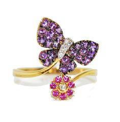 This unusual ring is playful, colourful and quirky featuring an amethyst butterfly and a pink sapphire encrusted flower. £932