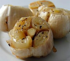 Roasted Garlic. Here's how: cut tops off of cloves (as in picture), place each head in one compartment on a muffin tin, pour 2 tbsp olive oil on top of each head, add fresh cracked pepper and maldon sea salt, cover lightly with aluminum foil, bake for 1 hour at 400°F. Spread on french bread or eat plain. So good.