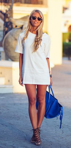 Janni Deler is wearing a white dress from Choies, blue bag from Celine and lace up shoes from BubbleRoom