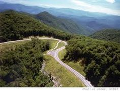 """The Cherohala Skyway was completed in the fall of 1996 after nearly thirty-four years.  Winding up and over 6,000 foot mountains for 15 miles in North Carolina and descending another 21 miles into the deeply forested backcountry of Tennessee. The road crosses through the Cherokee and Nantahala National Forests thus the name """"Chero...hala""""."""