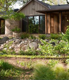 External: stone, perpendicular siding, picture windows, treepole porch supports