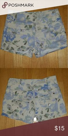 High rise floral denim shorts (juniors) NWOT. Cute high rise floral denim shorts. These have a small zipper along with 4 buttons. Functioning pockets in the front and back. Very light decorative distressing near front pockets and waistline. Not from urban outfitters, but tagged for exposure. Urban Outfitters Shorts Jean Shorts