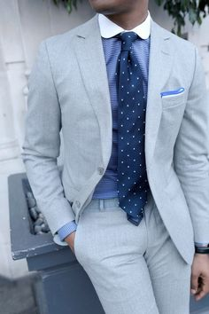 Light grey suit with polka dot tie