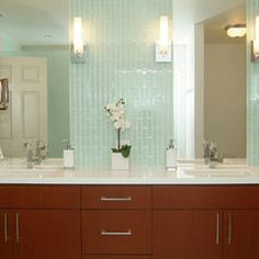 still some fun in terms of color choice for tile, and still a white counter, but cabinets could be a warm cherry and this bathroom would still feel more light and fun.