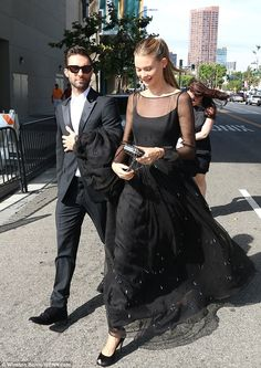 Chic in black: Levine skipped the razor and wore a tuxedo sans tie, while the Victoria's Secret Angel donned an elegant gown with sheer overlay