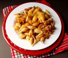 Cheesy Sausage and Tomato Shells-Good, simple and makes a lot. One to eat now and one to put in the freezer!