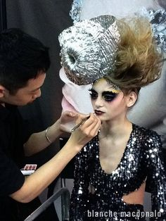 Blanche Macdonald graduate and instructor Tim Hung working on a creative makeup at the IMATS. http://www.blanchemacdonald.com/makeup/gallery/